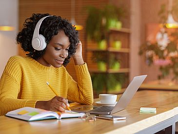 Black Girl with headset and labtop