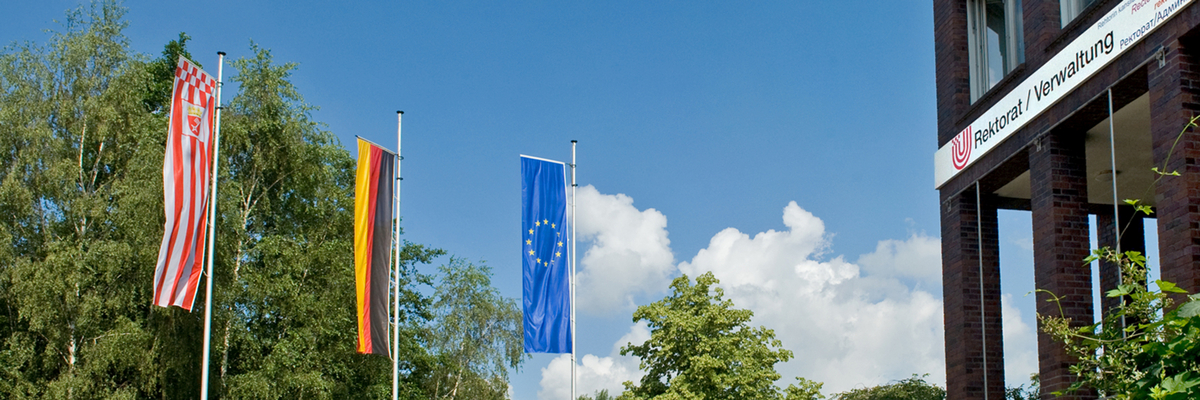The flags of Bremen, Germany and Europe fly in front of the University of Bremen.