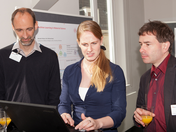 Carsten Lutz, Mareike Picklum, Stefan Bosse (all University of Bremen) discussion during the poster session