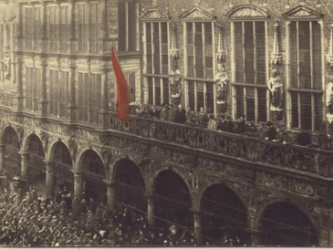 People hoists the red flag at the Bremen Town Hall