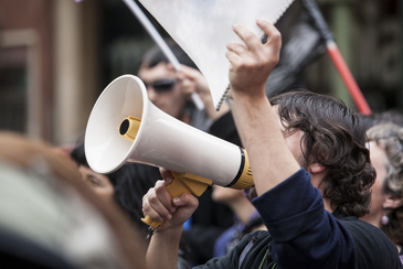 megaphone, demonstrator, protester, young, worker, strike, spain, manifestation, labor reform, cuts, crowd, politics, flags, flags, labor, banners, strike, street, urban, demonstration, protest, people, action, unions, society, unemployed, notebook