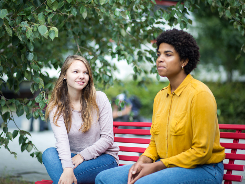 Two students in conversation outside.