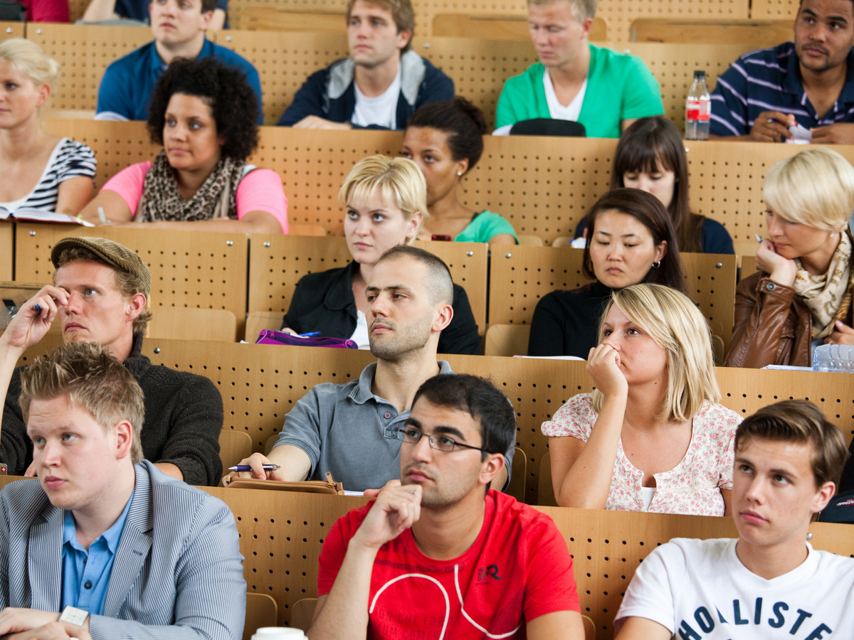 Students sit in the lecture hall.