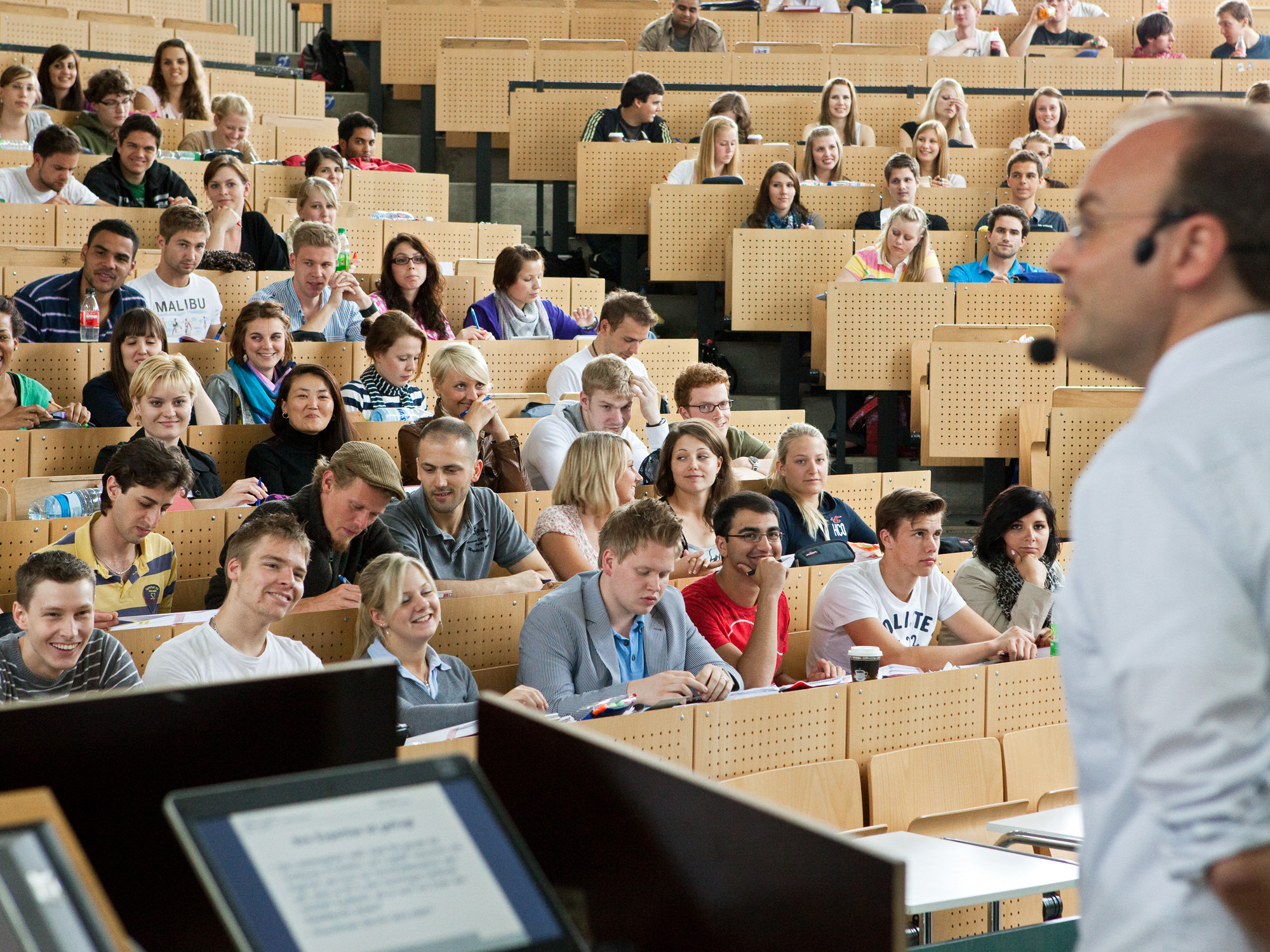 A lecturer in the full lecture hall.